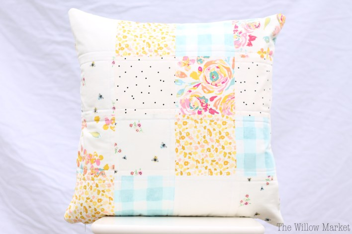 Springy quilted patchwork pillow cover. Fits an 18 by 18 inch pillow form.