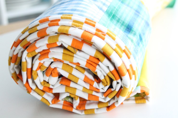 Making a story blanket out of vintage fabrics.