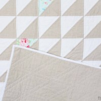 A farmhouse inspired low volume quilt. Made with half square triangles.