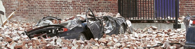 Seattle, WA, March 4, 2001 -- A sports car lies crushed by earthquake debris in a Seattle parking lot. FEMA News Photo by Kevin Galvin
