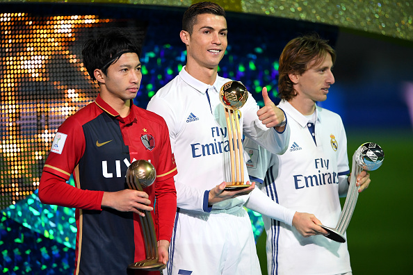 YOKOHAMA, JAPAN - DECEMBER 18: Golden boot winner Cristiano Ronaldo of Real Madrid(C) and 2nd place Luka Modric of Real Madrid(R) and 3rd place Gaku Shibasaki of Kashima Antlers(L) pose for photos end of the FIFA Club World Cup final match between Real Madrid and Kashima Antlers at International Stadium Yokohama on December 18, 2016 in Yokohama, Japan.  (Photo by Masterpress/Getty Images)