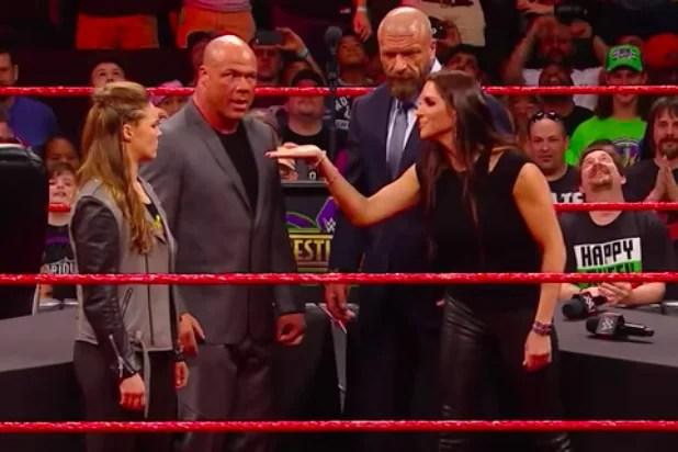 Watch Stephanie McMahon Slam Ronda Rousey Through a Table (Video)