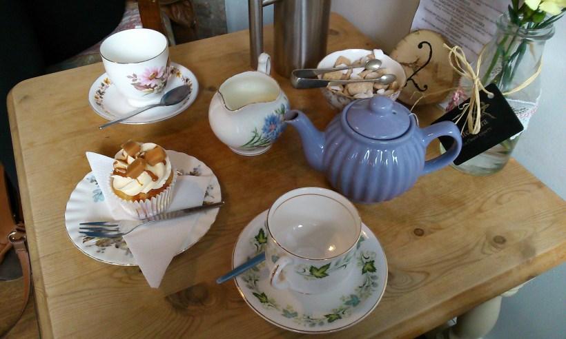 Tea and a gluten free cupcake at Crumbs Cupcakery. Copyright and image credit: Lilli Hender