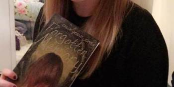 Chloe Grant-Jones with her book 'Forgotten in memory' Photo Credit: Grant-Jones