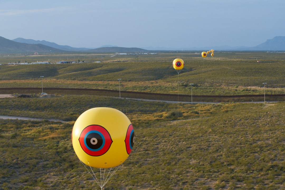 Postcommodity,Repellent Fence / Valla Repelente, October 9-12, 2015, Between the US/Mexico border cities of Douglas, Arizona and Agua Prieta, Sonora Twenty-eight tethered balloons 10 x 10 feet each