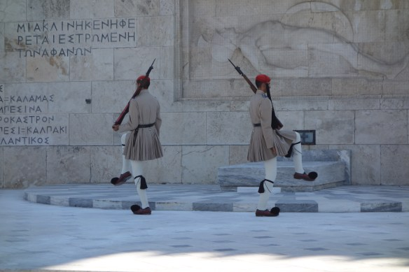 Guards in front of parliament, old Palace, performing,  ritual like Buckingham Palace. They have fluffy shoes.