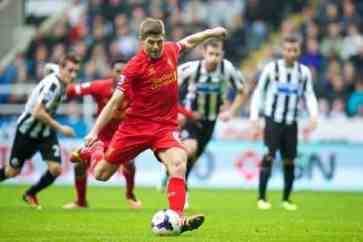 NEWCASTLE-UPON-TYNE, ENGLAND - Saturday, October 19, 2013: Liverpool's captain Steven Gerrard scores the first goal against Newcastle United from the penalty spot during the Premiership match at St. James' Park. (Pic by David Rawcliffe/Propaganda)