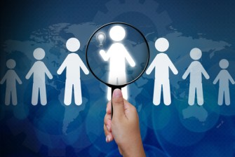 shutterstock_111003869 Choosing the talent person for hiring in magnifying glass copyright by shutterstock.com