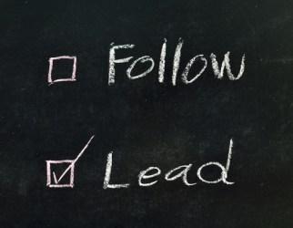 shutterstock_136777547 checking lead written on blackboard