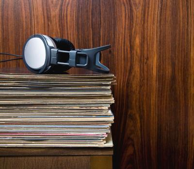 headphones-laying-on-stack-of-vinyl-records-steven-errico