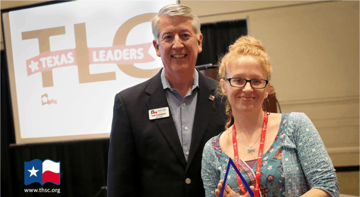 Photo of Abby with Tim Lambert after being awarded Leader of the Year