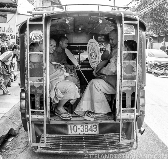 Thai Buddhist Monks in a Songthaew