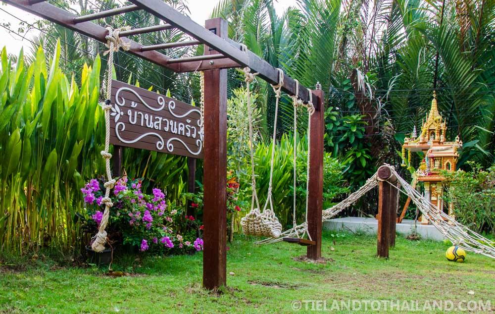 Swings and spirit houses at Baan Suan Krua, a homestay in Samut Songkhram