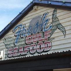 Faded sign painted on side of building for Fresh Guld Seafood in Fremantle, WA