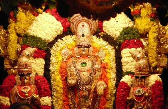 A Fully Decorated Sri Varu With Sri Devi And Bhudevi During Teppotsavam