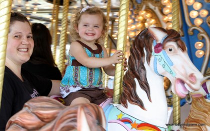 Lucy having fun on the carousel