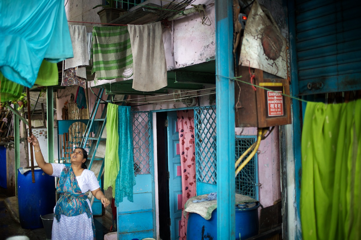 Though the residents of Yashwant Nagar in the Bandra suburb of Mumbai live in a congested neighborhood, they enjoy security of tenure and benefit from a strong civic sense - the result of a long-established community living in the area. Yashwant Nagar is about to be demolished to make way for a new housing development that will accomodate exisitng residents.   The BMC (Brihanmumbai Municipal Corporation) uses the UNDP-devised Human Development Index (HDI) as a measure by which to allocate resources.   Using parameters like population, literacy rate and infant mortality, and ranking wards in the order of performance, the BMC apportions funds to areas with lower education and higher mortality rates. The BMC also encourages the participation of Mumbai's citizens in the monitoring of education and health projects.  Photo: Tom Pietrasik Mumbai, India September 8th 2010