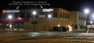 """Urban League building houses Planned Parenthood abortion business in Madison, WI. Our """"Choice Kills Those Without One"""" can be seen in the background in the parking lot."""