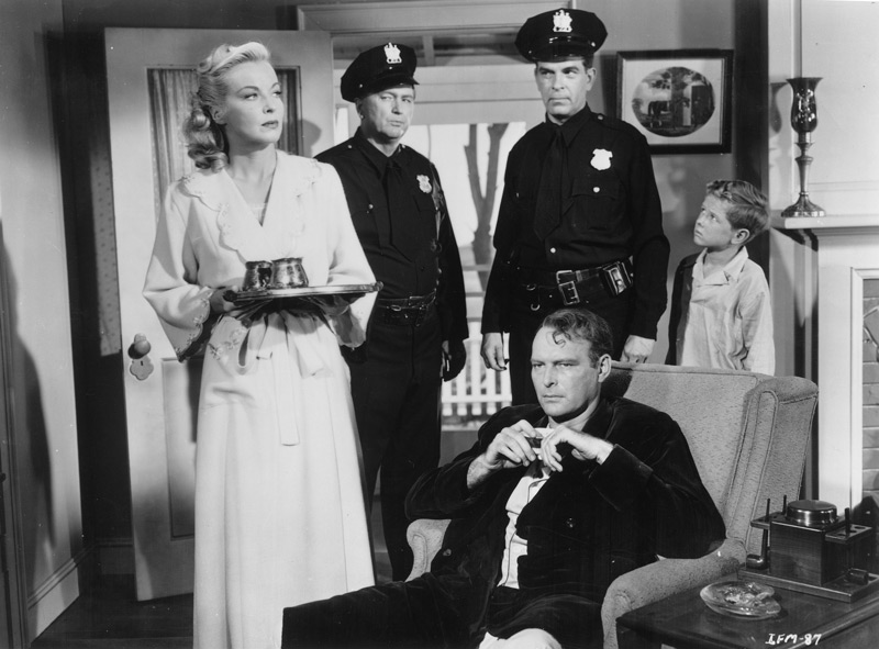 From left to right, Hillary Brooke as Mary MacLean, Charles Kane as Police Officer Blaine, Douglas Kennedy as Officer Jackson, Leif Erickson (seated) as George MacLean, and Jimmy Hunt as the MacLeans' twelve year-old son, David. Click to enlarge.