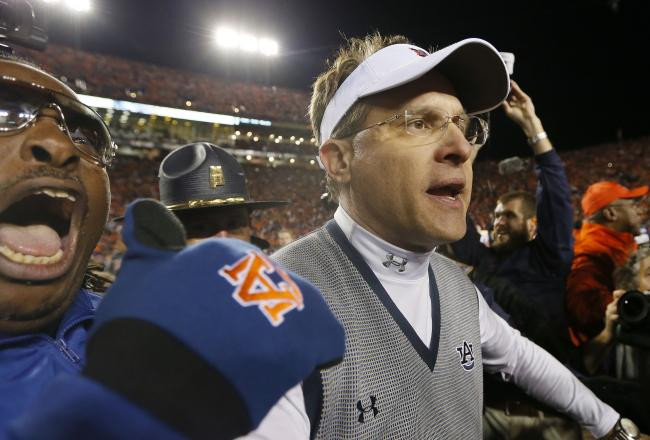 hi-res-452665277-head-coach-gus-malzahn-of-the-auburn-tigers-celebrates_crop_north
