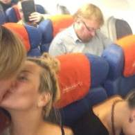 Lesbians Protest Anti-Gay Russian Lawmaker with Airplane Kiss: PHOTO