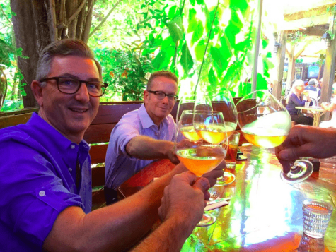 Gay men enjoying wine during Gay Wine Weekend in Sonoma as seen in gay travel magazine ManAboutWorld