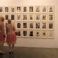 Art lovers at a gallery during Art Basel in Miami in Towleroad and ManAboutWorld gay travel magazine