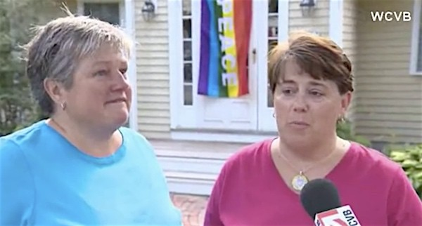After gay couple's home is vandalized, a community rallies