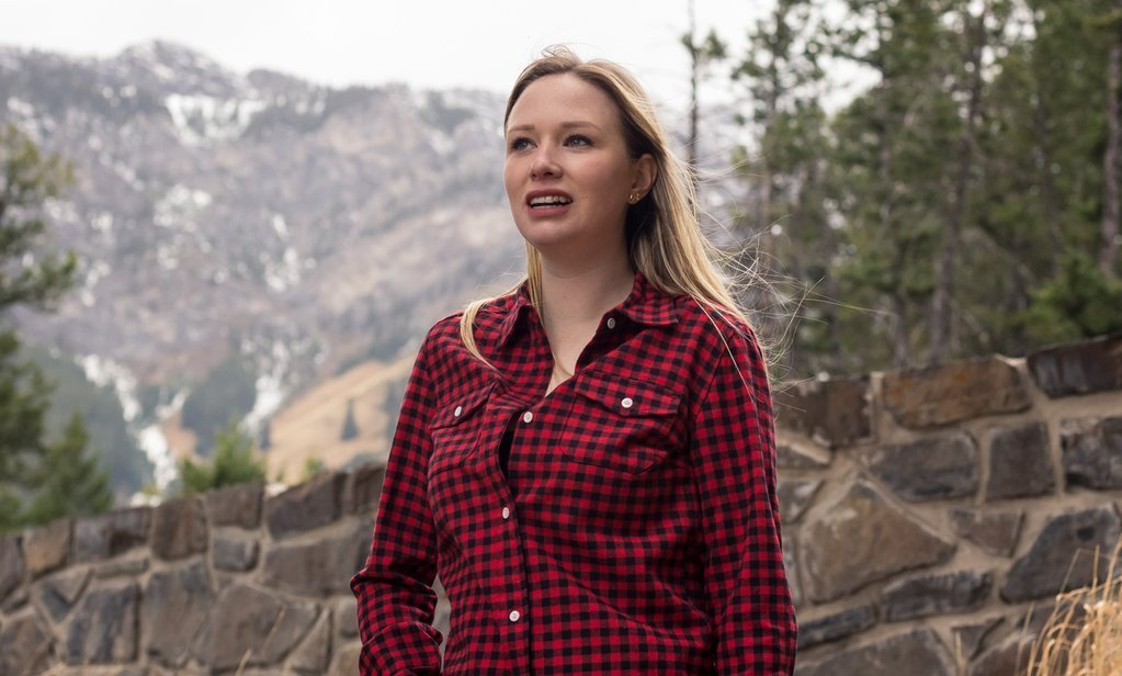A Flannel Shirt modeled by a woman at the Rocky Mountain Flannel Company in Banff.
