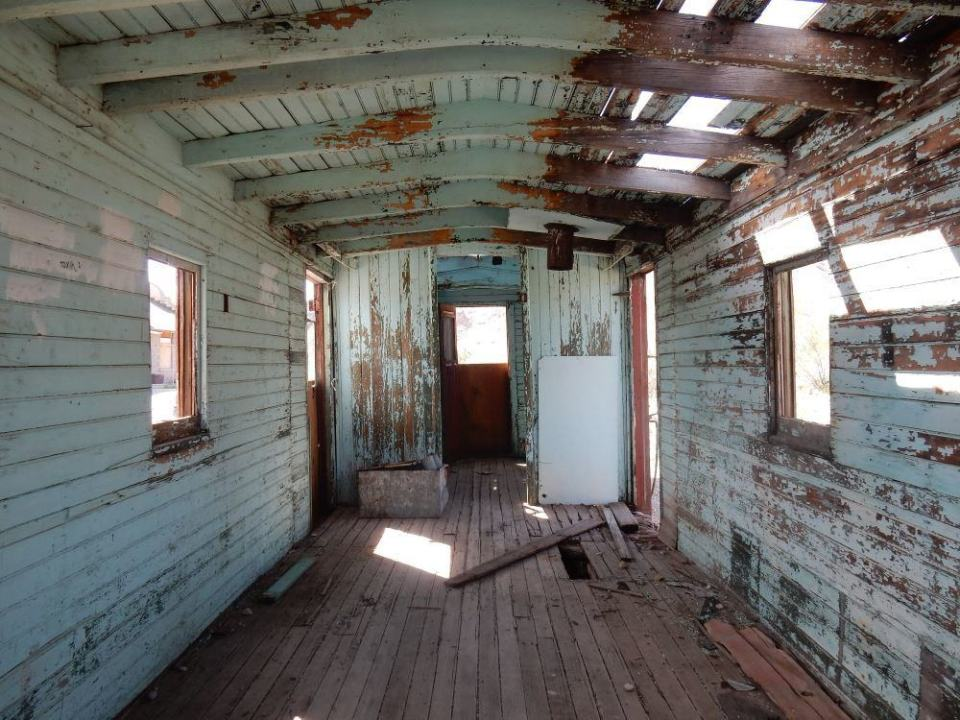 This was once a railroad trailer, then a gas station, now a ruin.