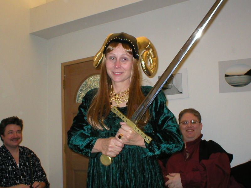 My mom. We don't typically see eye-to-eye on much, but she supported our decision. And she looks really cool with the sword!