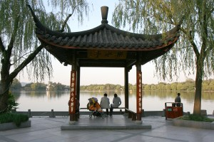 A couple Rests under Pagoda at West Lake Hangzhou, China