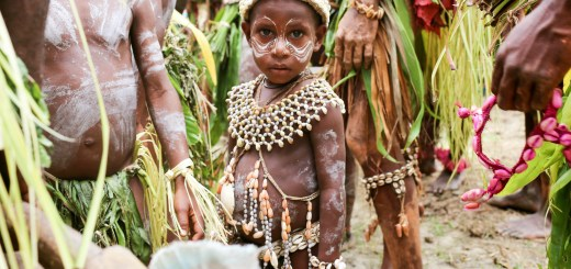 A boy wearing kina, shells – the old currency of the Sepik