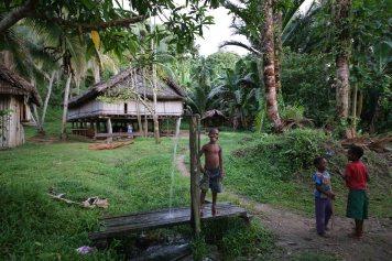 A boy shows off in Wagu village, Sepik River