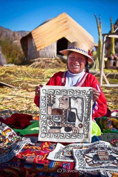 Handicraft vendor on Floating Island of the Uros on Lake Titicaca, Peru