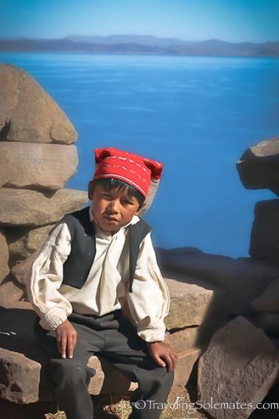 Boy wearing traditional cap on Taquile Island, Lake Titicaca, Peru