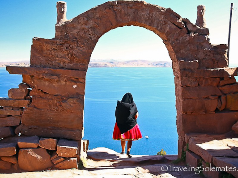 Woman under the arch on Taquile Island, Lale Titicaca, Peru