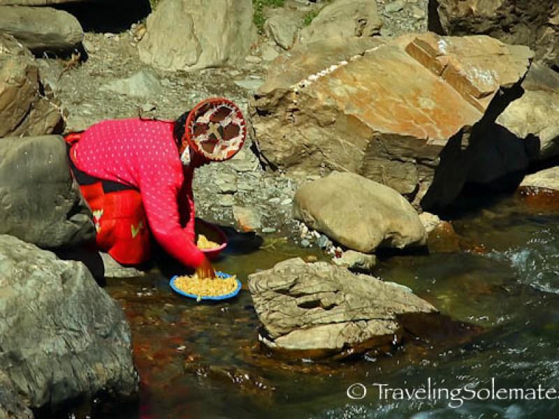 Woman washing on riiver in Patacancha on Lares Valley Trek Peru
