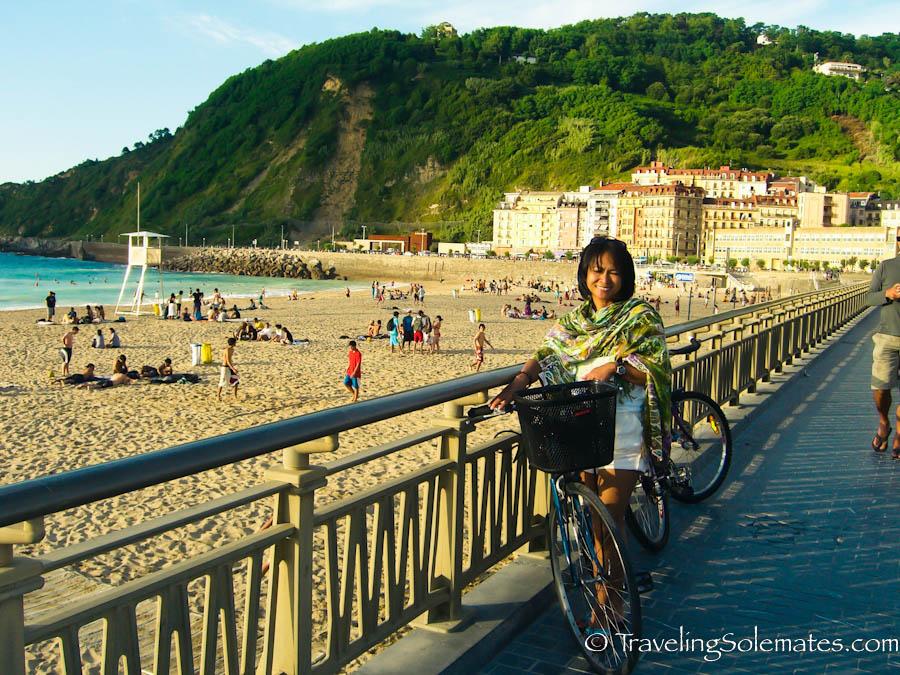 Biking along Playa de la Zurriola, San Sebastian, Spain