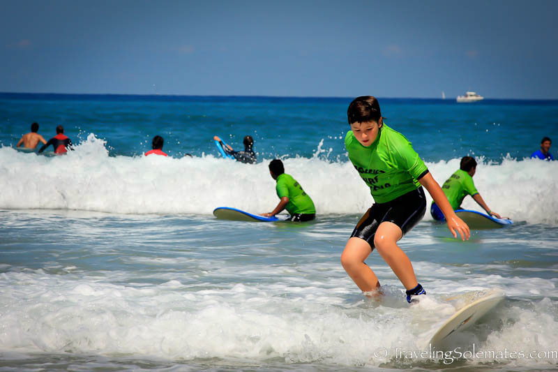 Boy Surfing in Zurriola Beach, San Sebastian, Spain