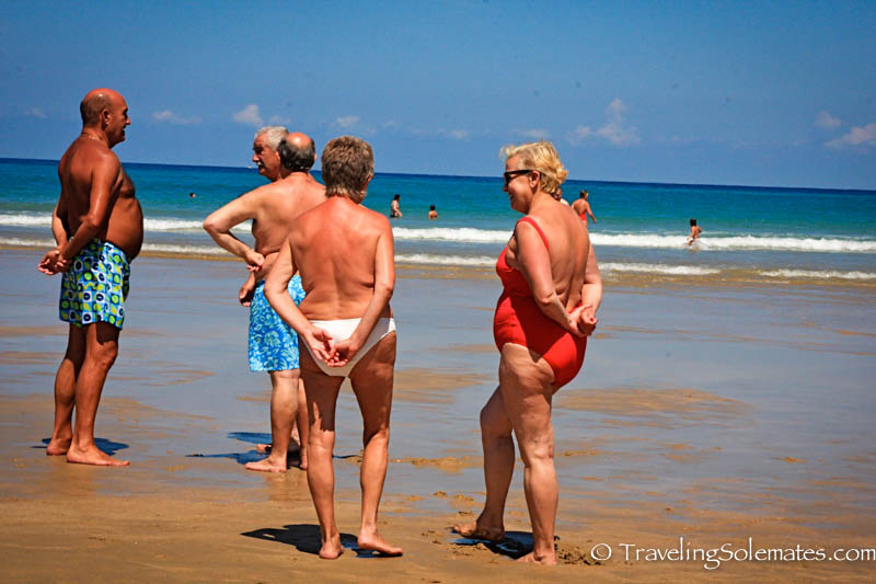 Old people at Zurriola Beach, San Sebastian, Spain
