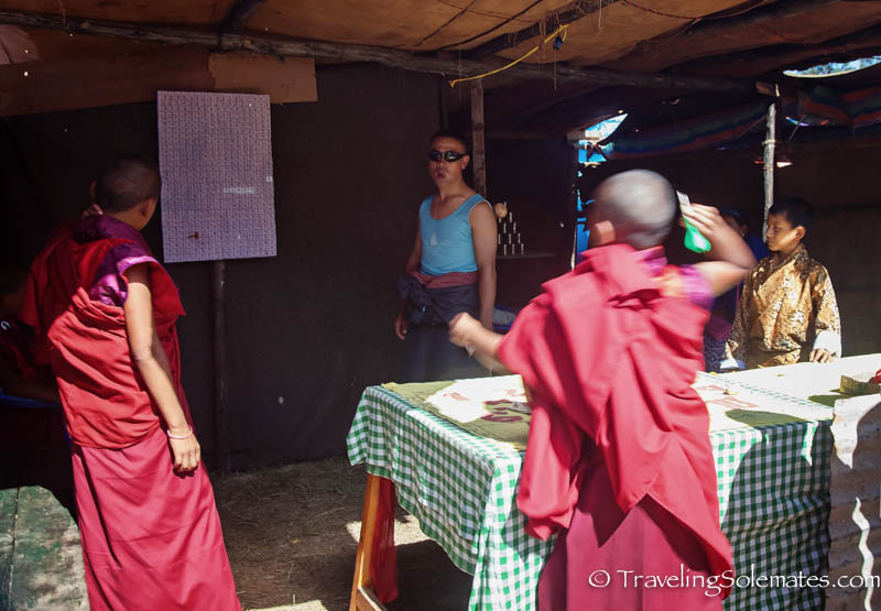 A monk playing dart during Tsechue Festival in Wangdue, Bhutan