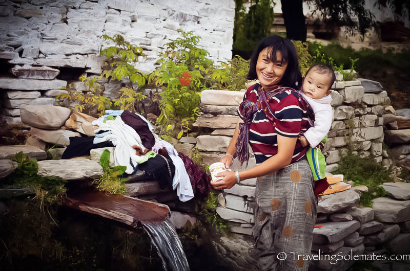 Mother and child washing in Ura Valley, Bumthang, Bhutan