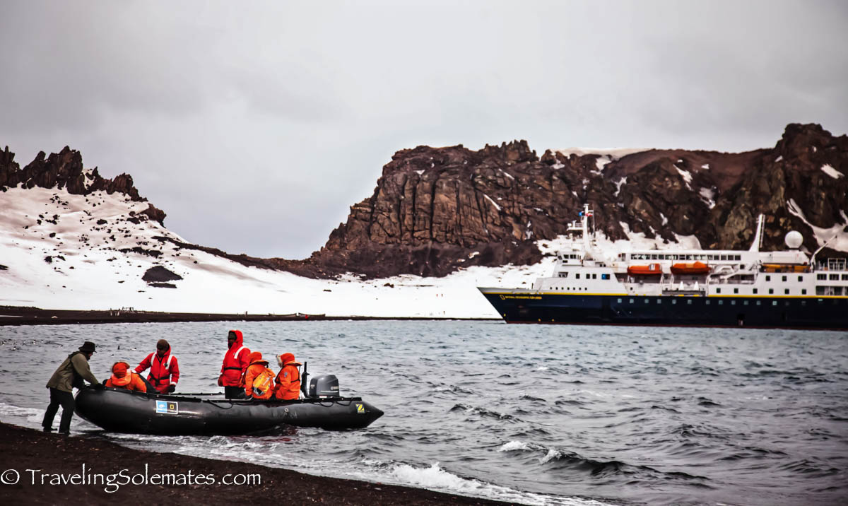 Zodiac boat arriving on Deception Island, National Geographic Explorer, Antarctica Expedition