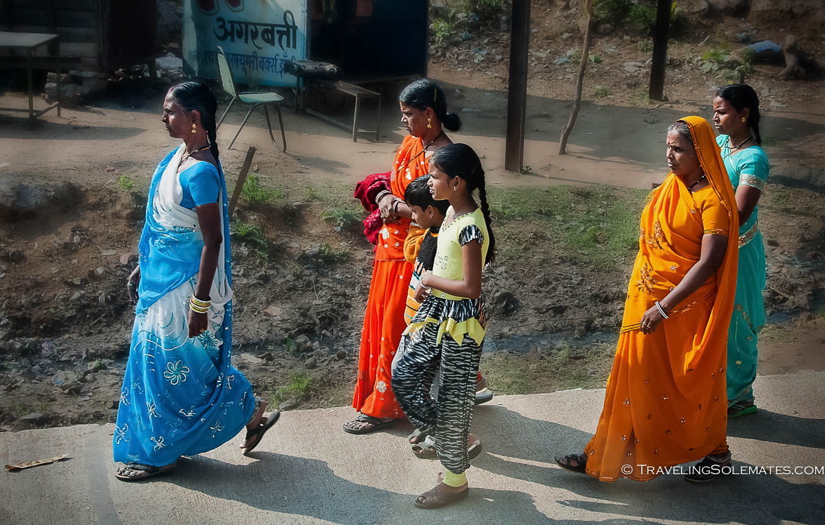 Women walking on street, Orchha India