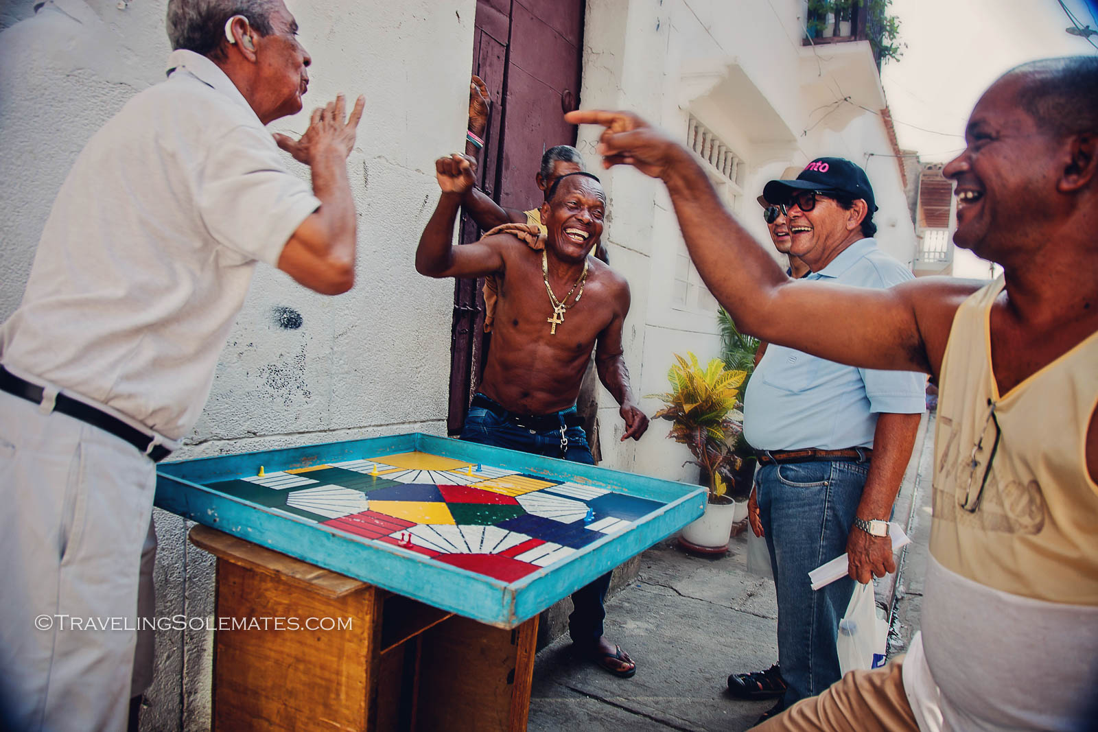 Locals playing games on the street in Getsemani, Cartagena, Colombia