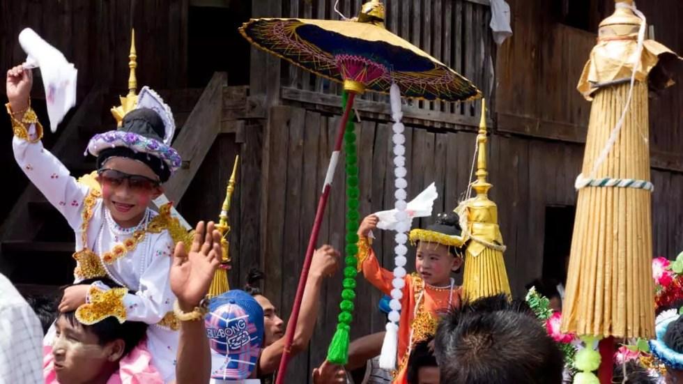 Boys hoisted above in celebration, Myanmar