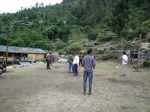 Playing Volleyball with locals of Sewa Village on Day 2 of Rupin Pass Trek. In the background, is our stay