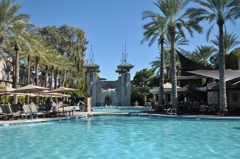 The paradise pool has a 92-ft waterslide through its art deco waterfall.