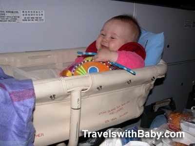 Baby in airplane bassinet TravelswithBaby.com